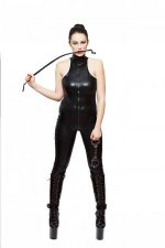 sexy-woman-in-latex-catsuit-holding-handcuffs-and-bite-whip-picture-id516467097.jpg